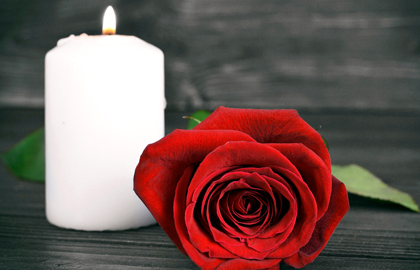 Burning Candle Beside A Rose