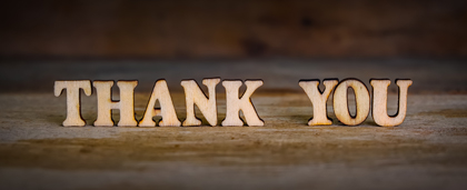 The Word Thank You Spelled Out In Wood Blocks